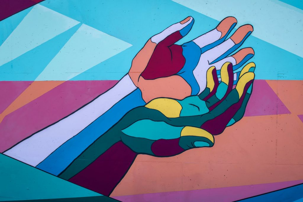 A photo of colorful extended hands
